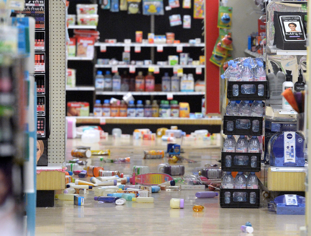 Description of . Merchandise covers the floor after the 5.1 eartchquake at at the CVS store in La Habra on Friday March 28, 2014. (Staff Photo by Keith Durflinger/Whittier Daily News)