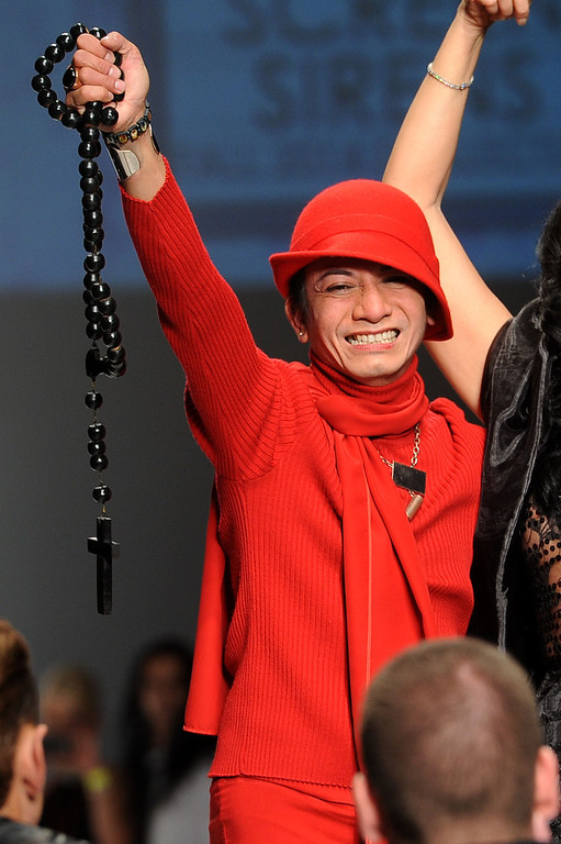 Description of . Designer Andre Soriano makes an appearnace at the conclusion of his fashion show during L.A. Fashion Week March 10, 2014 in Los Angeles, CA.(Andy Holzman/Los Angeles Daily News)