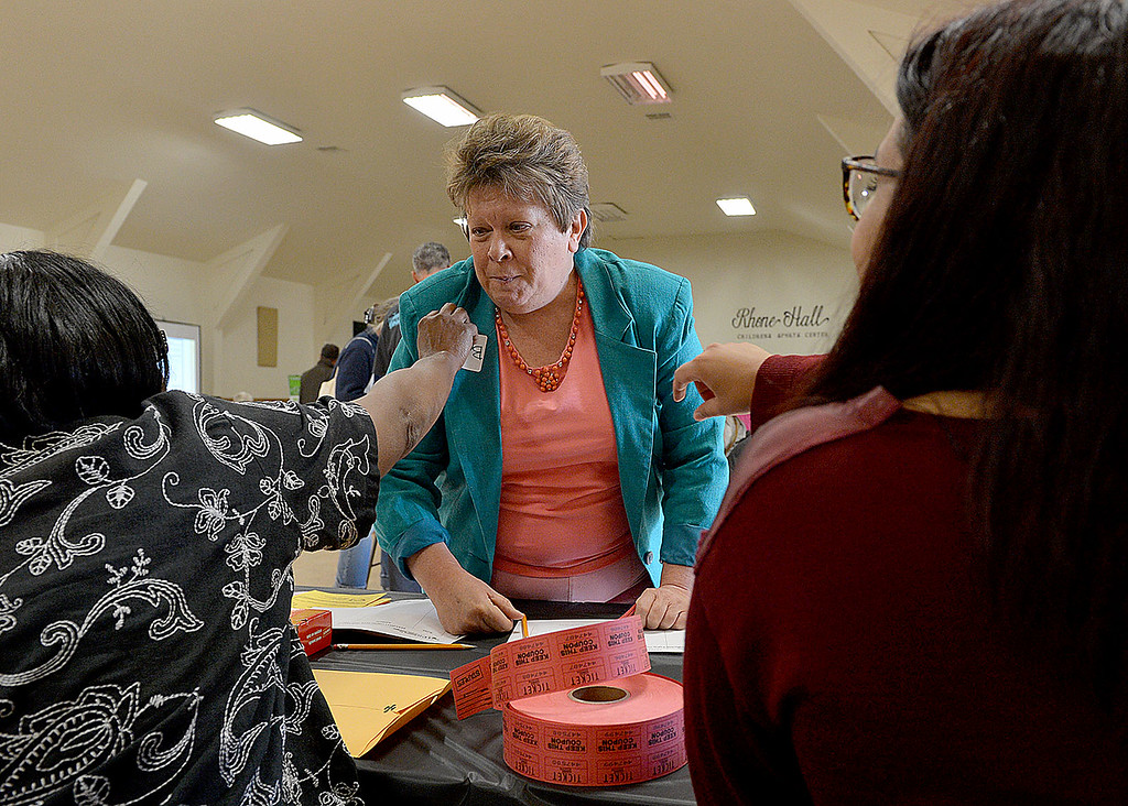 Description of . Barbara Babcock, of San Bernardino, joins other residents in a high-crime area of San Bernardino and an organization aiming to reduce crime and violence in the area during a meeting Thursday April 3, 2014 in the gym at The Church of Nazarene. Representatives of the IPS Byrne Project, an initiative by the Institute for Public Strategies, will discuss ways that residents can help drive the effort to reclaim the neighborhood. (Staff photo by Rick Sforza/The Sun)