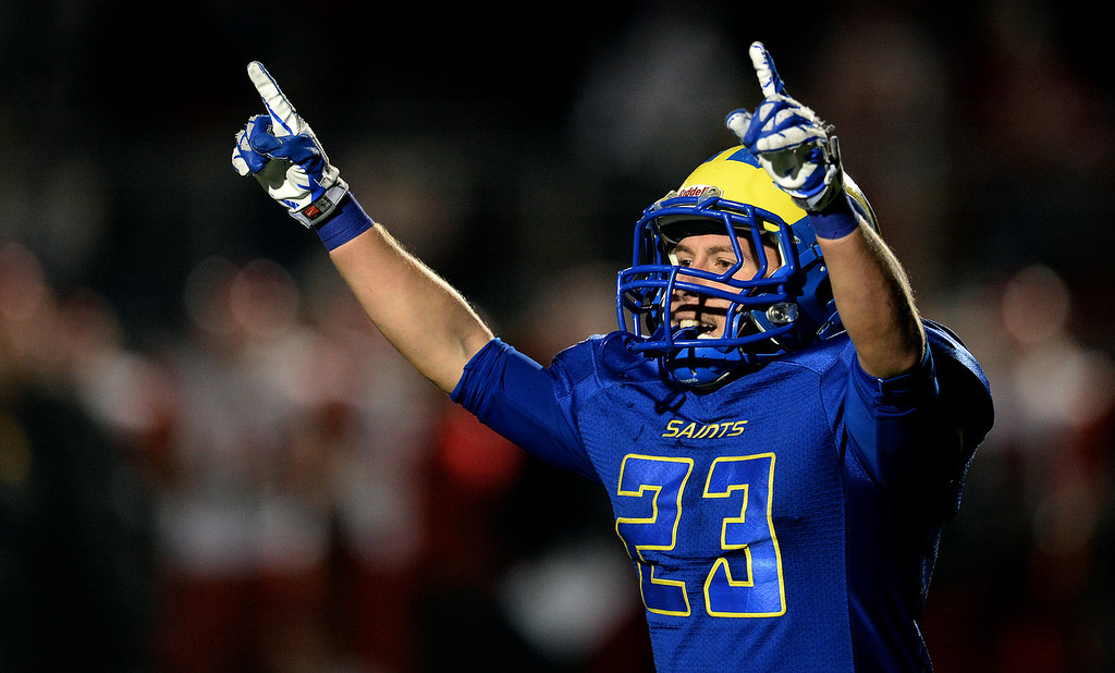 Description of . San Dimas' Joseph Mayorga points to the sky after scoring a touchdown against Paraclete in the fourth quarter of a CIF-SS Mid-Valley Division championship football game at San Dimas High School in San Dimas, Calif., on Friday, Dec. 6, 2013. San Dimas won 20-14.  (Keith Birmingham Pasadena Star-News)