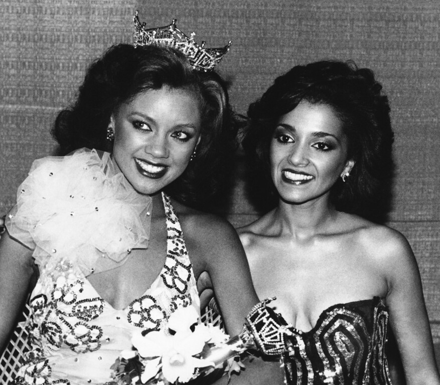 Description of . Miss America of 1984 Vanessa Williams, left, of New York poses with Miss New Jersey Suzette Charles, after Williams was crowned, Sept. 19, 1983 in Atlantic City. (AP Photo)