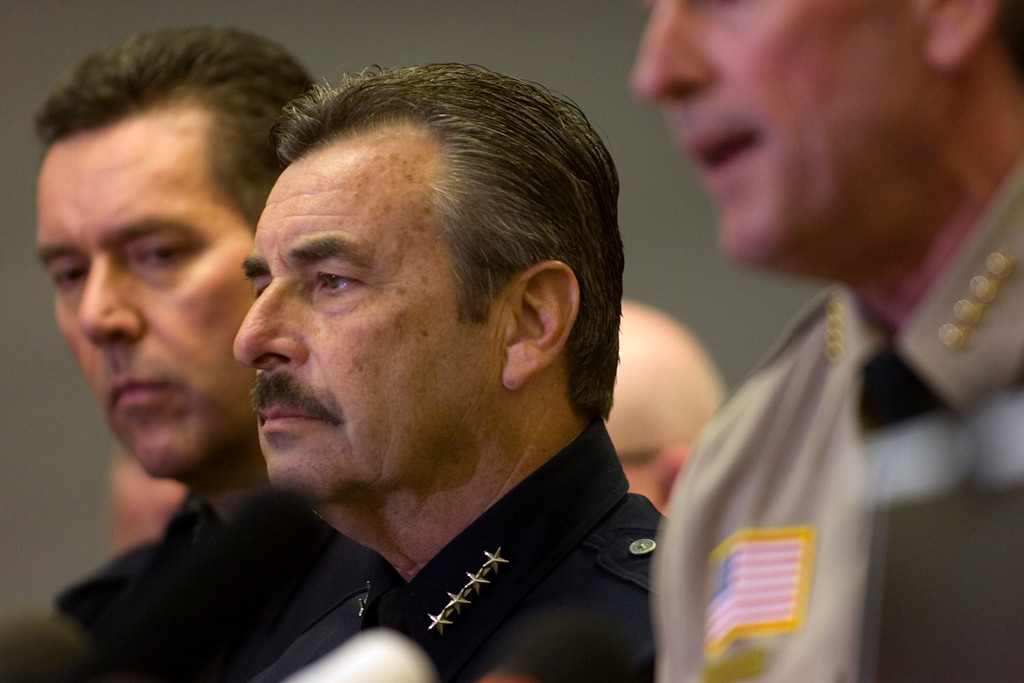 Description of . LAPD Chief Charlie Beck listens as the San Bernardino County Sheriff's Department holds a press conference Wednesday, February 13, 2013, at the San Bernardino County Sheriff's Headquarters in San Bernardino. (Staff photo by Jennifer Cappuccio Maher/Inland Valley Daily Bulletin)