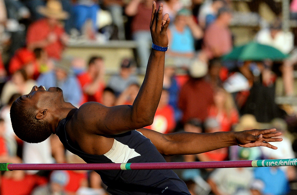 Description of . Carter's Eric Moore competes in the high jump during the CIF-SS Masters Track and Field meet at Falcon Field on the campus of Cerritos College in Norwalk, Calif., on Friday, May 30, 2014.   (Keith Birmingham/Pasadena Star-News)