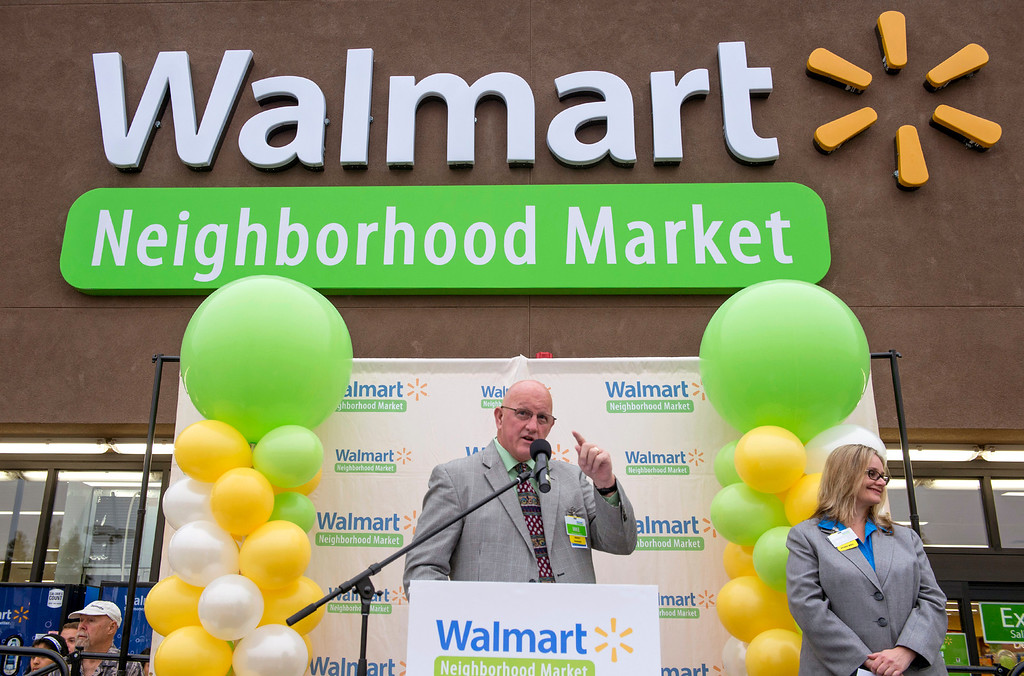 Description of . Walmart market manager Mike Acheson speaks during the grand opening of Walmart Neighborhood Market at 1425 N. Hacienda Boulevard in La Puente, Calif. October 2, 2013.  (Staff photo by Leo Jarzomb/SGV Tribune)