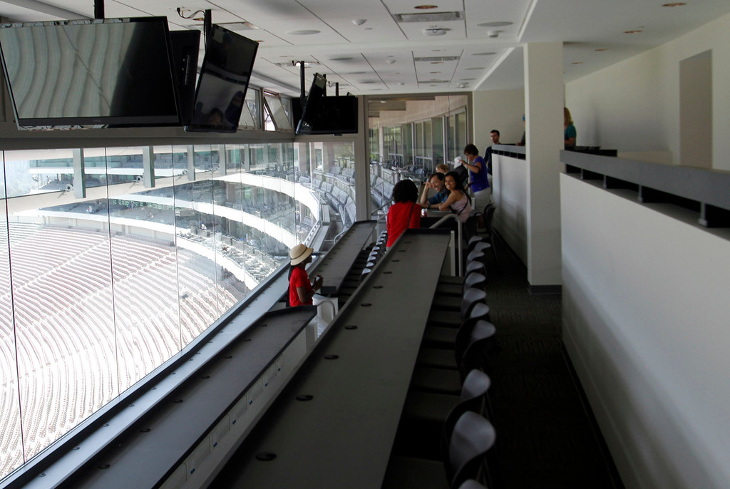 Description of . Guests sit the Press Box of the newly renovated Pavilion at the Rose Bowl in Pasadena, Saturday, June 8, 2013. The new $84 million Pavilion completed this spring after more then two years of construction, contains premium seating section, press box, sound system and stadium security operations. (Correspondent Photo by James Carbone/SXCITY)