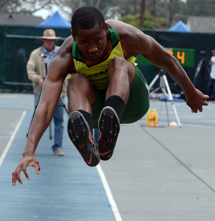 Description of . Long Beach Poly's Vincent Calhoun competes in the division 1 long jump during the CIF Southern Section track and final Championships at Cerritos College in Norwalk, Calif., Saturday, May 24, 2014. 
