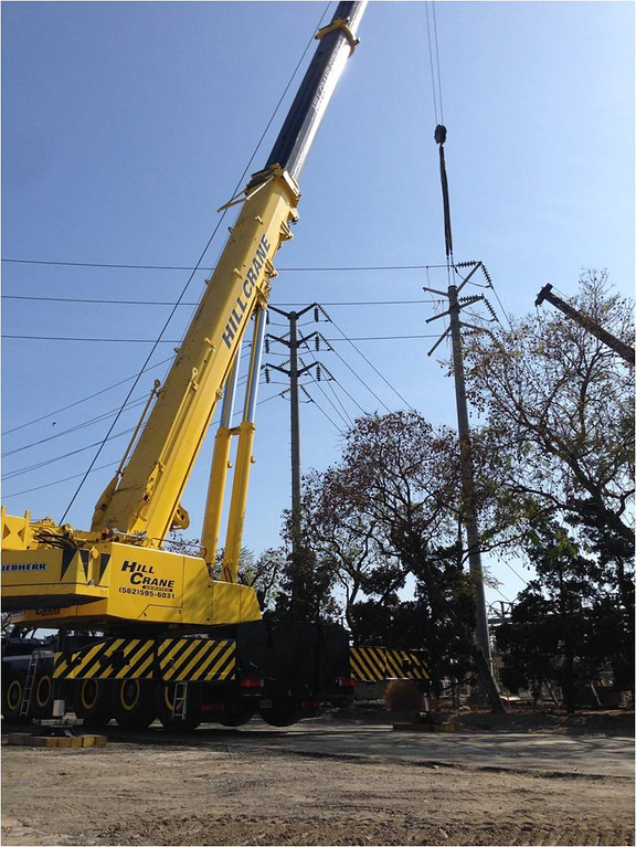Description of . A giant crane moves a SoCal Edison power pole for one of the many concurrent ACE projects.