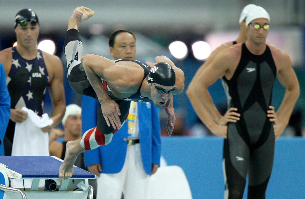 Description of . US swimmer Michael Phelps starts to his leg of the men\'s 4x100-meter freestyle relay final during the swimming competitions in the National Aquatics Center at the Beijing 2008 Olympics in Beijing, Monday, Aug. 11, 2008. (AP Photo/David J. Phillip)