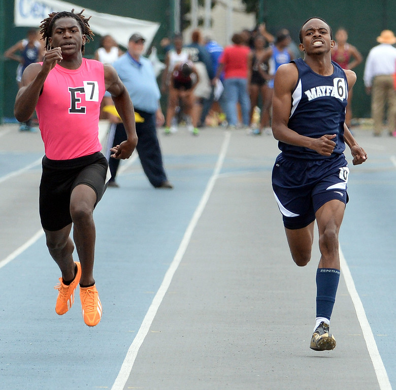 Description of . Mayfair's Justin Parker, right, along with Eastside's Joshua Cummings competes in the division 2 400 meters race during the CIF Southern Section track and final Championships at Cerritos College in Norwalk, Calif., Saturday, May 24, 2014. 