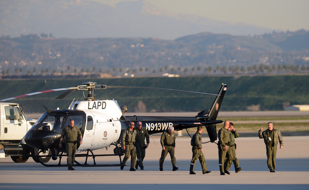 Description of . Various police agencies stage at San Bernardino International Airport Tuesday, February 12, 2013, in San Bernardino in response to a shoot with Christopher Dorner. (Staff photo by Jennifer Cappuccio Maher/Inland Valley Daily Bulletin)