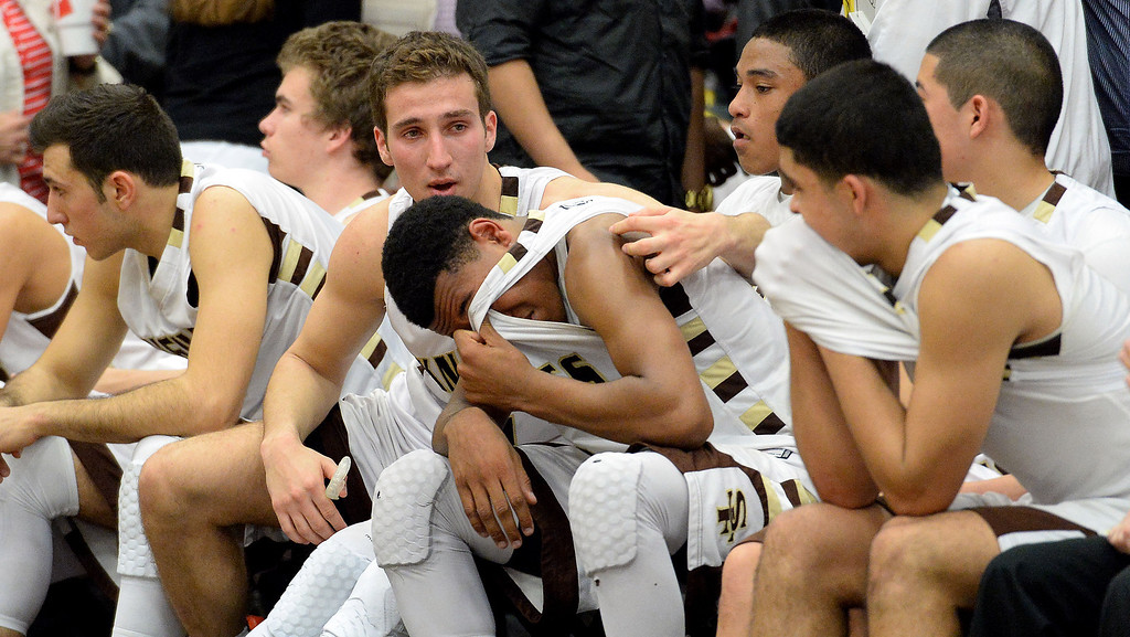 Description of . St. Francis' Kyle Leufroy, center, is consoled by teammates after Oak Park won 60-53 during a CIF-SS Division 3A Championship basketball game at the Felix Event Center on the campus of Azusa Pacific University in Azusa, Calif., on Friday, March 7, 2014.  (Keith Birmingham Pasadena Star-News)