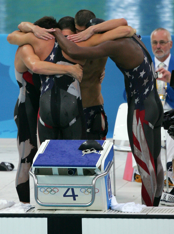 Description of . Members of the U.S. relay team jubilate after setting a world record to win the men\'s 4x100-meter freestyle relay final  during the swimming competitions in the National Aquatics Center at the Beijing 2008 Olympics in Beijing, Monday, Aug. 11, 2008. They are from left: Garrett Weber-Gale, Jason Lezak, Michael Phelps and Cullen Jones. (AP Photo/Greg Baker)
