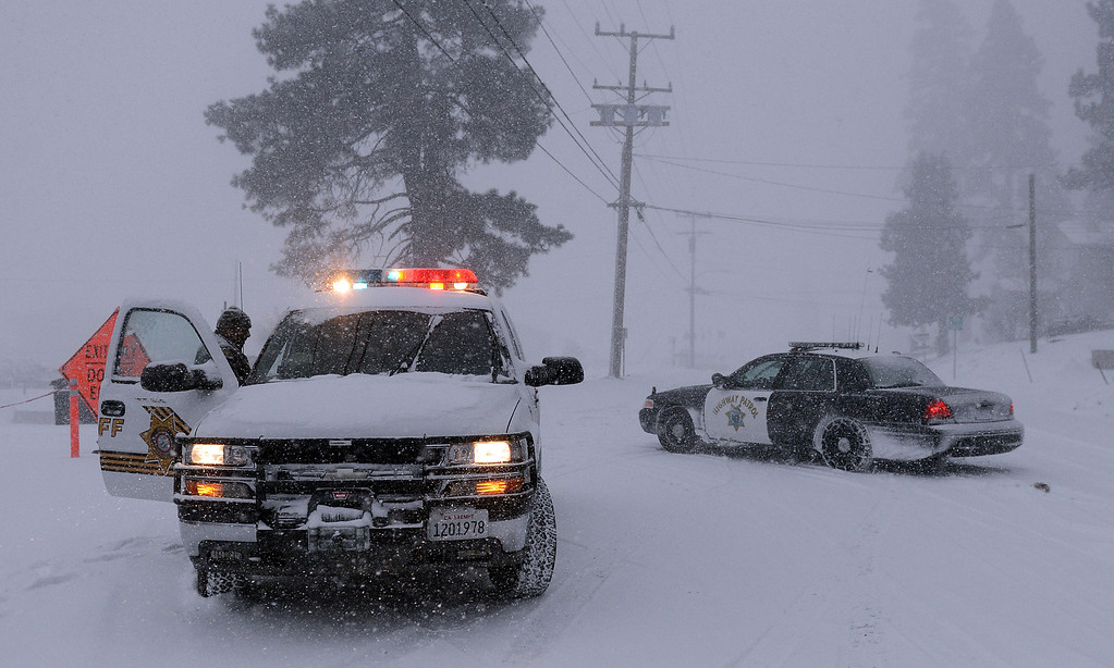 Description of . San Bernardino County Sheriff deputies along with other law enforcement agencies continue the manhunt for Christopher Jordan Dorner Friday February 8, 2013 near Bear Mountain in Big Bear.(Staff photo by Will Lester/Inland Valley Daily Bulletin)
