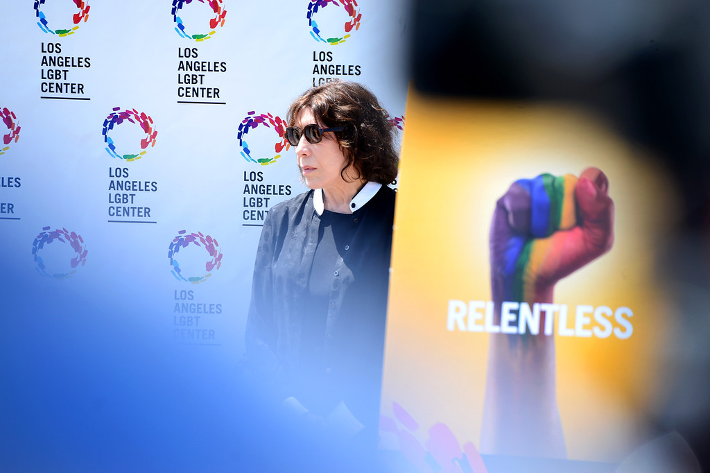 Description of . Comedian Lily Tomlin attends a press conference for the Los Angeles LGBT Center's $25 million campaign announcement to develop an affordable housing campus for LGBT youth and seniors Tuesday, May 27, 2014 on Santa Monica Boulevard in Hollywood and adjacent to their cultural center. Around 40 percent of the more than 6,000 homeless youth in Los Angeles identify as lesbian, gay, bisexual or transgender and the city has 65,000 LGBT seniors according to the L.A. Gay & Lesbian Center. The center has raised $19 million. (Photo by Sarah Reingewirtz/Pasadena Star-News)