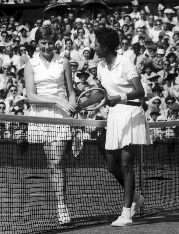 Description of . Althea Gibson of New York, right, and Christine Truman of Woodford, Essex, England, left, shake hands over the net after their ladies? singles semi-final of the All-England Lawn Tennis championships at Wimbledon, London, England on July 4, 1957. Miss Gibson won 6-1, 6-1. (AP Photo/John Rider-Rider)
