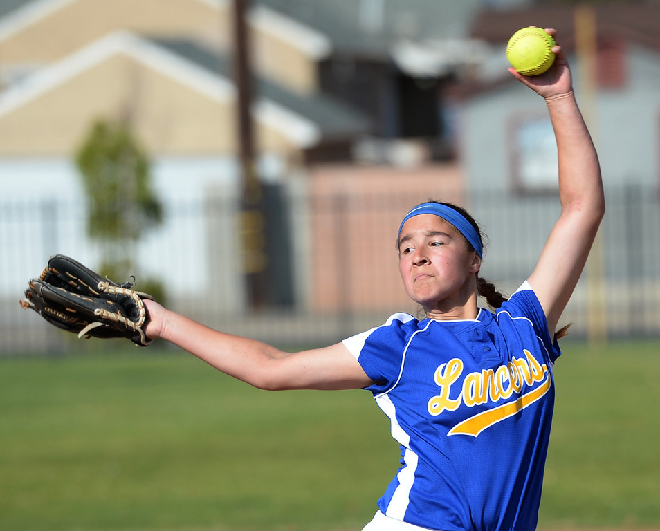 Description of . Bishop Amat's Anissa Sanchez (#20) makes a pitch as they play St. Paul in their Del Rey League girls softball game at York Field in Whittier on Thursday March 27, 2014. St. Paul defeated Bishop Amat 7-5. (Staff Photo by Keith Durflinger/Whittier Daily News)