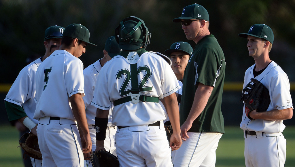 Description of . Bonita head coach John Knott, second from right, talks to his team in the first inning of a prep baseball game against San Dimas at Bonita High School in La Verne, Calif., on Wednesday, March 19, 2014.  (Keith Birmingham Pasadena Star-News)
