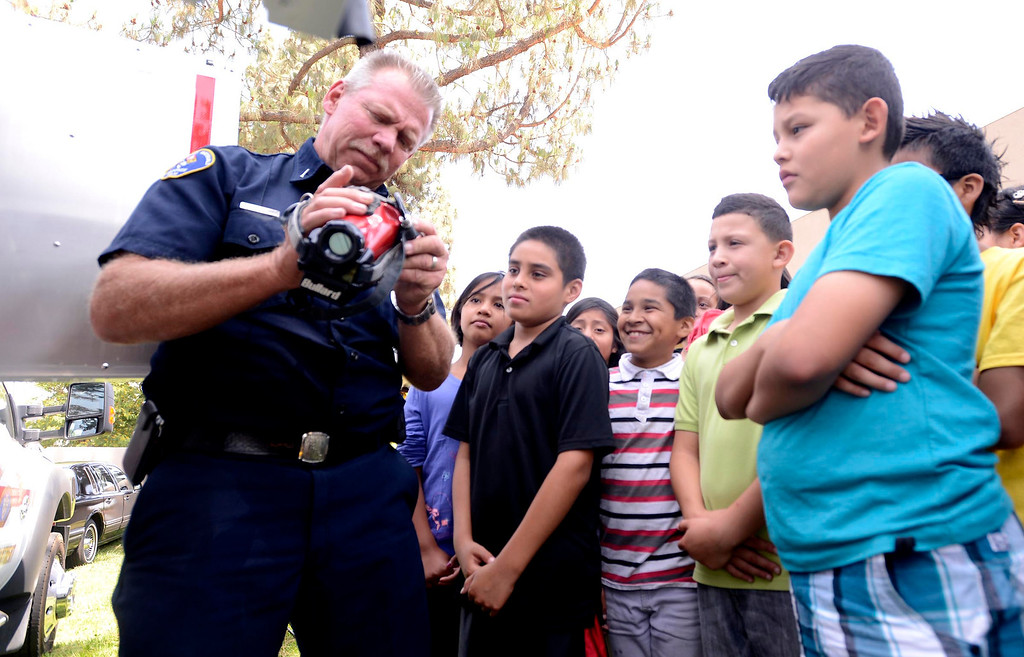 Description of . Brian Otter of San Bernardino County Fire/ Hazardous Material speaks to students about his Thermal Imaging Camera (TIC) during the final day of the 19th Annual Career Awareness Week at Lankershim Elementary School in Highland June 6, 2013.
