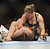 UFC womens bantamweight champion Ronda Rousey applies an arm-bar to  challenger Liz Carmouche for a first round submission victory during their UFC 157 match at the Honda Center in Anaheim, CA Saturday, February 23, 2013. (Hans Gutknecht/Staff Photographer)