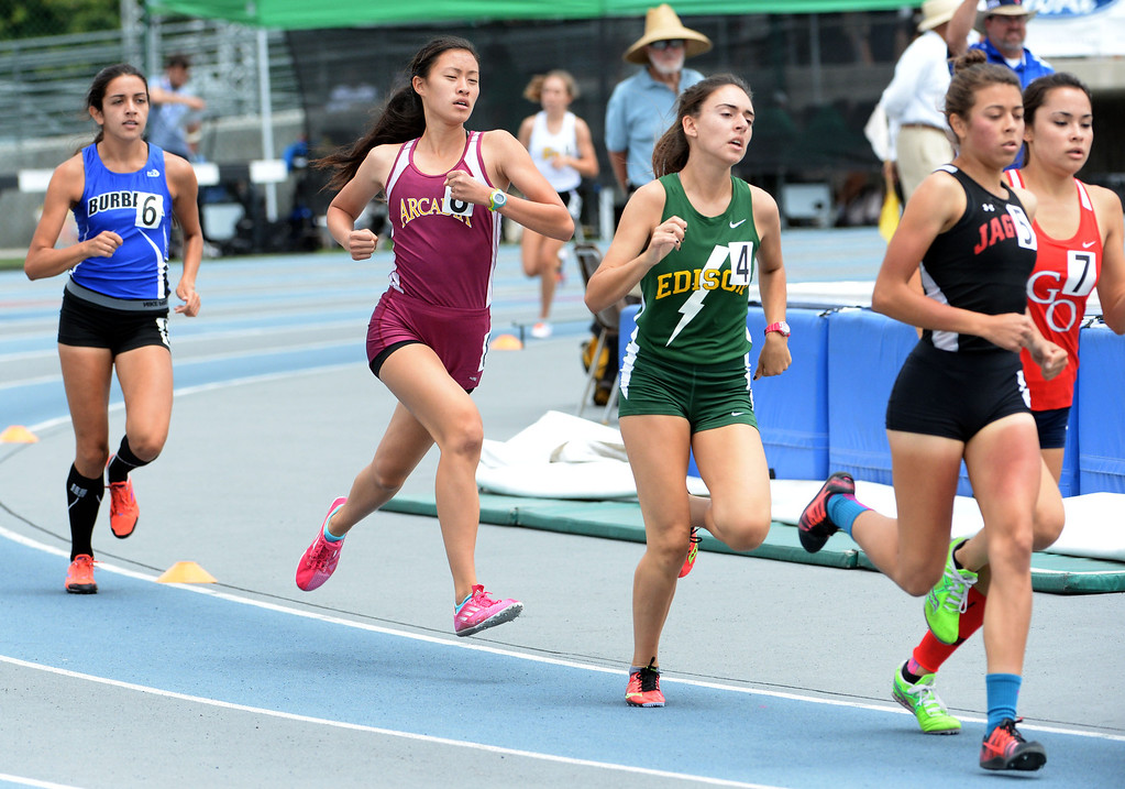 Description of . Arcadia's Veronica Yamane competes in the division 1 1600 meter run during the CIF Southern Section track and final Championships at Cerritos College in Norwalk, Calif., Saturday, May 24, 2014. 