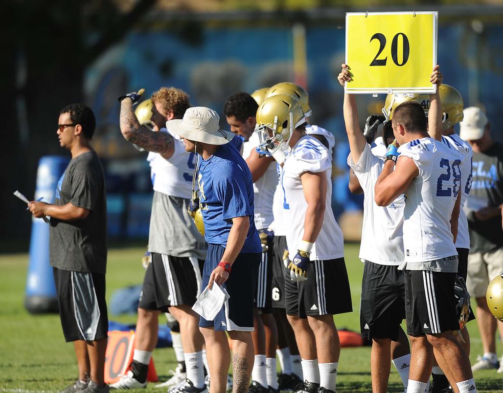 Description of . UCLA football team Second day preseason training camp practices at Cal State San Bernardino on Thursday, Aug. 8, 2013. LaFonzo Carter/ Staff Photographer