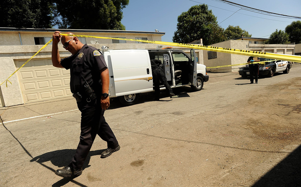 Description of . Pomona Police investigate the scene a double-shooting along the 300 block of Orchid Lane in Pomona August 11, 2013.   GABRIEL LUIS ACOSTA/STAFF PHOTOGRAPHER.