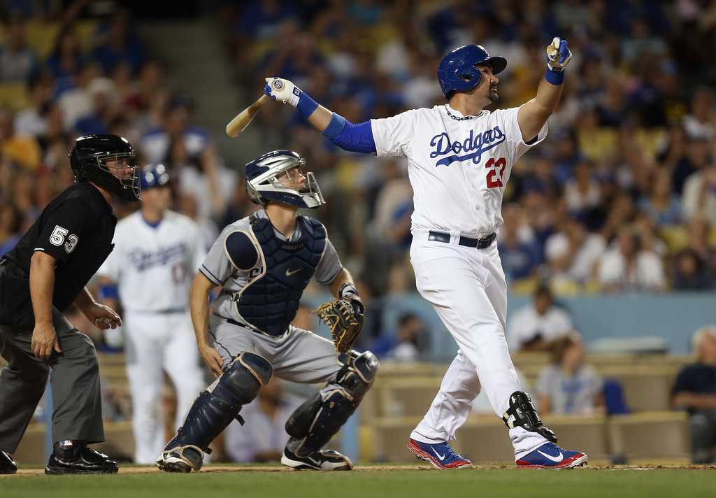 Description of . Adrian Gonzalez #23 of the Los Angeles Dodgers hits a two-run home run against the San Diego Padres in the third inning at Dodger Stadium on August 30, 2013 in Los Angeles, California.  Dodgers won 9-2.  (Photo by Jeff Gross/Getty Images)