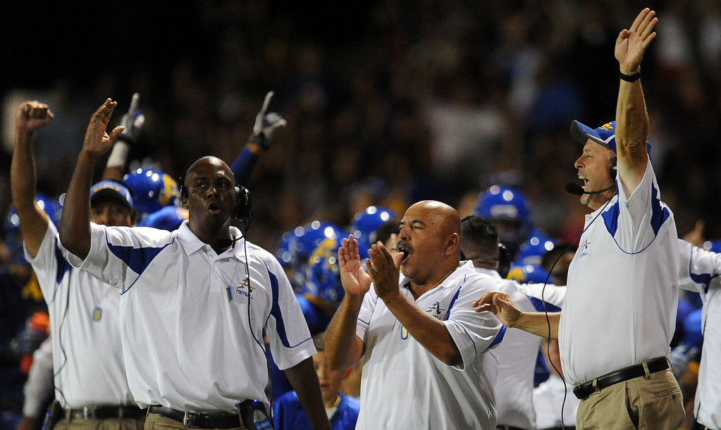 Description of . Bishop Amat's coaching staff with heck coach Steve Hagerty, right, react as Trevon Sidney ( not pictured) recovers a Santa Margarita fumble and runs back for a touchdown in the second half of a prep football game at Bishop Amat High School on Friday, Aug. 30, 2013 in La Puente, Calif. Bishop Amat won 38-28.   (Keith Birmingham/Pasadena Star-News)