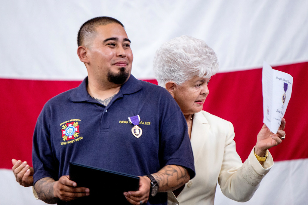 Description of . Congresswoman Grace Napolitano gives Sgt. Luis Bardales, a resident of Irwindale who works for the city of South Pasadena, a congressional award after he received a Purple Heart at the Army National Guard in Azusa Saturday, July 12, 2014. Bardales was wounded by a roadside IED in Baghdad, Iraq and saved gunner Gabriel Herrera by pulling him out of their Humvee before another IED explosion. (Photo by Sarah Reingewirtz/Pasadena Star-News)
