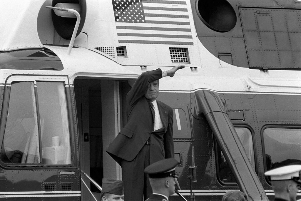 Description of . On the day of his resignation, Aug. 9, 1974, Richard M. Nixon waves goodbye from the steps of his helicopter as he leaves the White House following a farewell address to his staff.  The Watergate scandal forced Nixon to become the first U.S. president to resign from office.  (AP Photo/Chick Harrity)
