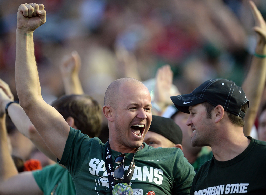 Description of . Michigan State fans facts after a touchdown against Stanford in the second half of the 100th Rose bowl game in Pasadena, Calif., on Wednesday, Jan.1, 2014. Michigan State won 24-20.