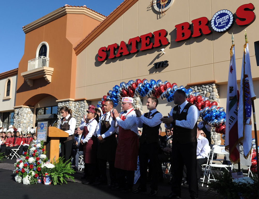 Description of . (John Valenzuela/Staff Photographer) Stater Bros. manager Sandy Schnell introduces her team of managers during the grand opening of the grocery store in Redlands, Wednesday, September 25, 2013. The new store replaces the one directly across the street, offering more amenities and services, including a bakery, seafood counter and wider aisles.