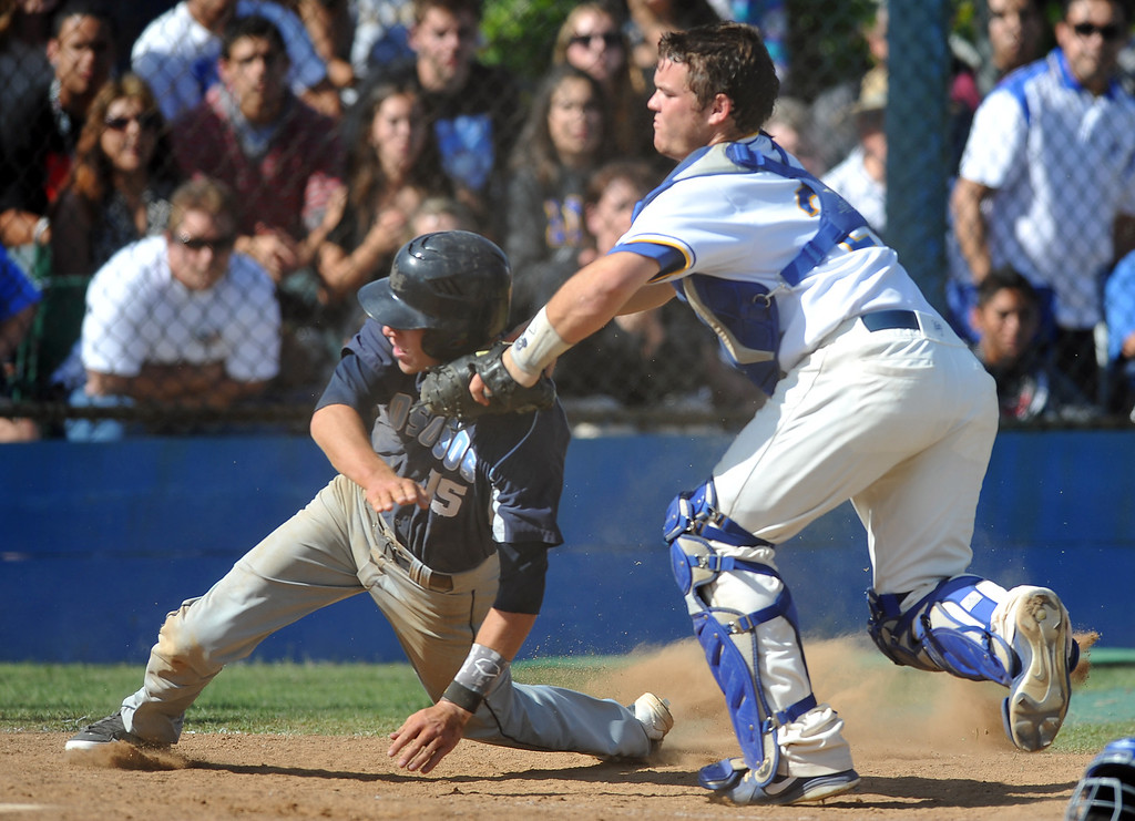 Description of . La Mirada catcher Jeff Murray (#29) tags out Los Osos' Kevin Riley (#15) at home plate in their CIF quarterfinal baseball game at La Mirada High School on Friday May 24, 2013. Los Osos beat La Mirada 8-5. (SGVN/Staff Photo by Keith Durflinger)