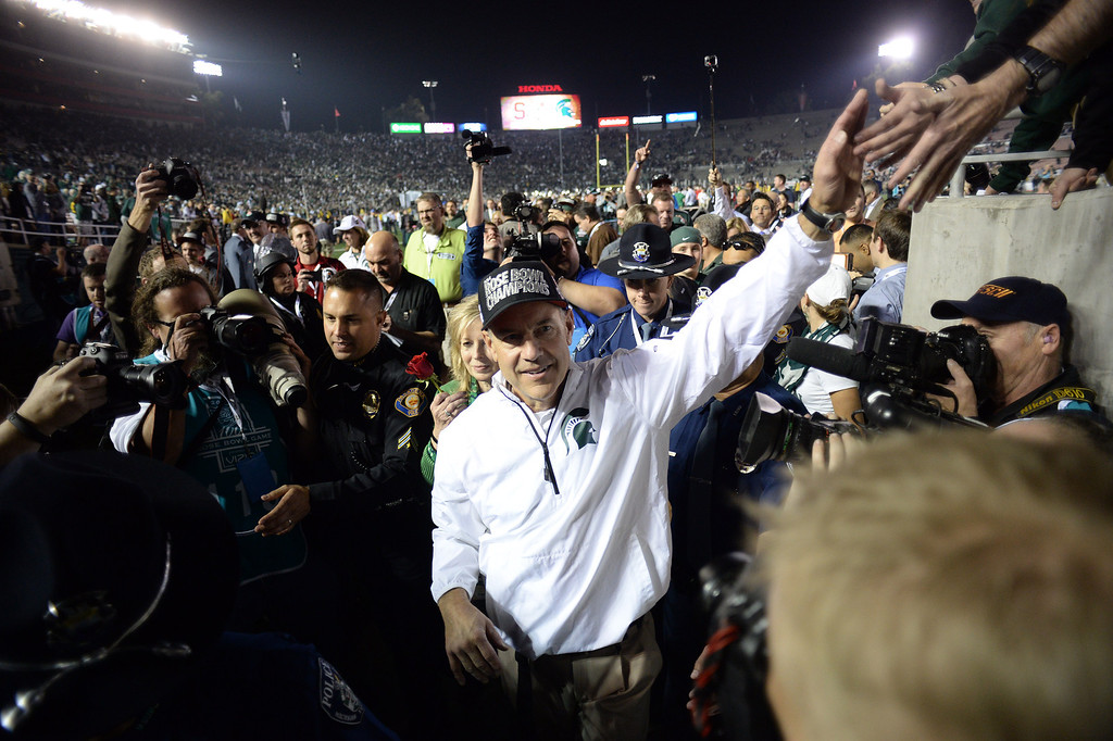Description of . Michigan State head coach Mark Dantonio walks in the locker room after winning  the 100th Rose Bowl game in Pasadena Wednesday, January 1, 2014. Michigan State defeated Stanford 24-20. (Photo by Hans Gutknecht/Los Angeles Daily News)