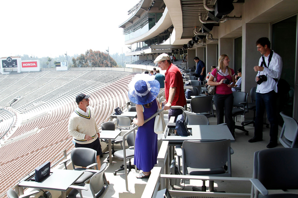 Description of . Guests tour the Loge area of the newly renovated Pavilion at the Rose Bowl in Pasadena, Saturday, June 8, 2013. The new $84 million Pavilion completed this spring after more then two years of construction, contains premium seating section, press box, sound system and stadium security operations. (Correspondent Photo by James Carbone/SXCITY)