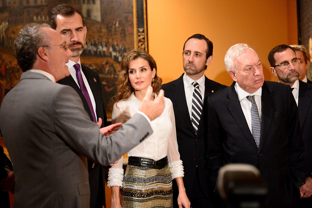 Description of . Professor Steven Hackel, left, shows The Crown Prince Felipe and Princess Letizia of Spain and their Spanish entourage the Junipero Serra exhibition at The Huntington Library in San Marino Saturday night, November 16, 2013. (Photo by Sarah Reingewirtz/Pasadena Star-News)