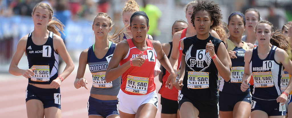 Description of . Redondo's Amber Gore (2) wins the 800 meter run Invitational during the Mt. SAC Relays in Hilmer Lodge Stadium on the campus of Mt. San Antonio College in Walnut, Calif., on Saturday, April 19, 2014. 