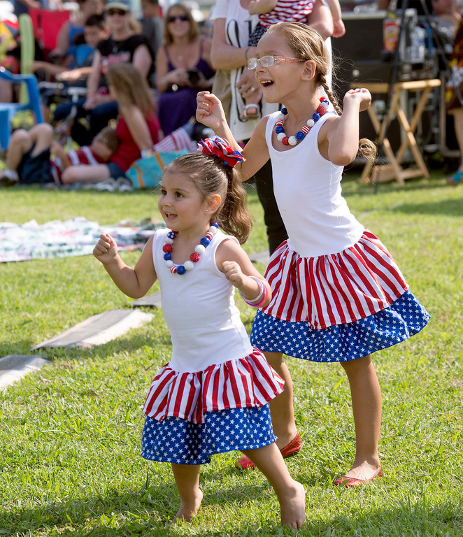Description of . Tristian Longacre , 3, left, and Trinity Schlotterbeck, 5, dance to the live band at La Mirada's annual Independence Day Celebration at La Mirada Regional Park July 3, 2013.   (SGVN/Staff photo by Leo Jarzomb)