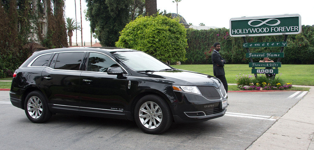 Description of . Guests of Mick Jagger and close family members of his girlfriend LWren Scott depart Hollywood Forever Cemetery following her funeral in Hollywood, California on March 25, 2014.  The model-turned-fashion designer was found hanged in her luxury New York apartment last week. She was 49. The cemetery was closed for the roughly one-hour service, held amid tight security.           (JOE KLAMAR/AFP/Getty Images)