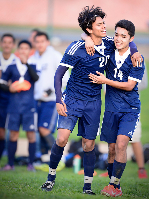 Description of . Baldwin Park's Danny Vega (20) celebrates with Eric Garces (14) his second goal as they defeat Northview 2-0 during Tuesday's game at Northview High School, February 11, 2014. Vega has made 31 goals this season. (Photo by Sarah Reingewirtz/Pasadena Star-News)
