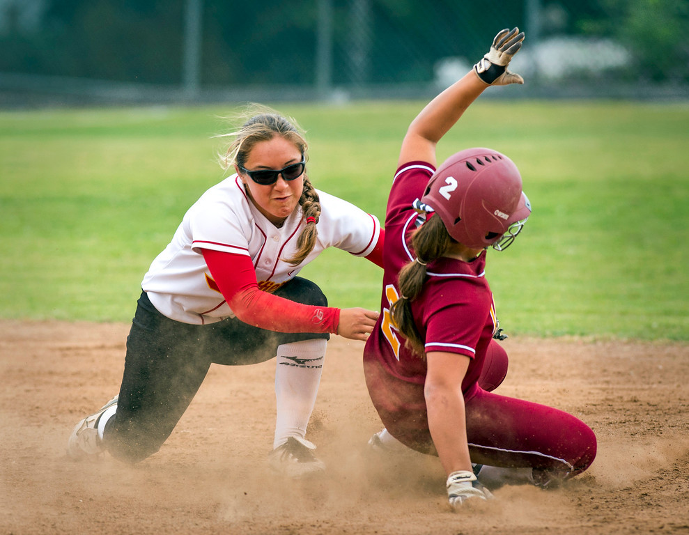 Description of . Whittier Christian High 2B Erica Romo tags La Serna High's Danielle Garcielita out before dropping the ball in the fourth inning vs  at La Serna's Whittier campus field March 25, 2014.  (Staff photo by Leo Jarzomb/Whittier Daily News)