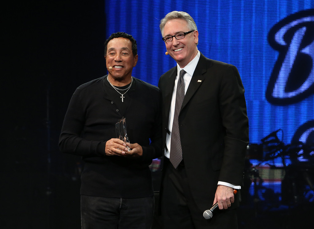 Description of . ANAHEIM, CA - JANUARY 23:  Singer/Songwriter Smokey Robinson and NAMM President and CEO Joe Lamond attends the 2014 National Association of Music Merchants show media preview day at the Anaheim Convention Center on January 23, 2014 in Anaheim, California.  (Photo by Jesse Grant/Getty Images for NAMM)