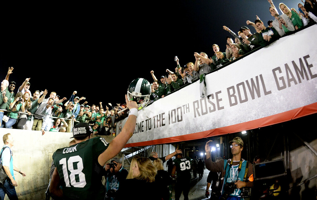 Description of . Michigan State's Connor Cook (18) celebrates after defeating Stanford 24-20 during the 100th Rose bowl game in Pasadena, Calif., on Wednesday, Jan.1, 2014. 