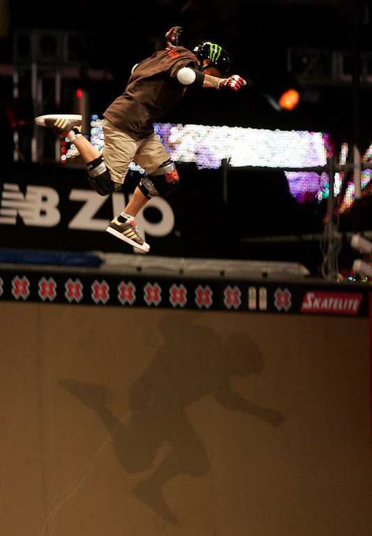 Description of . Skateboarder Jake Brown looses his skateboard and has a horrific fall during the X-games 13 at the Staples Center in Los Angeles on August 2, 2007.  He was able to walk away after a few minutes of medical attention from paramedics on scene.  (SGVN/Staff Photo by Raul Roa/Sports)