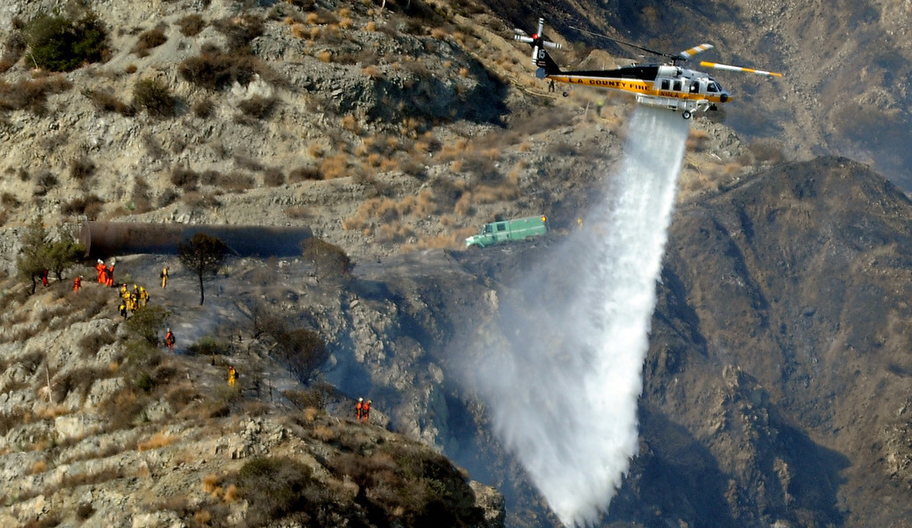 Description of . Los Angeles County Firefirghters and camp crews with aid of water dropping helicopters battle a five acre brush fire in the San Gabriel Mountains above Azusa just above the former Shooting range on Tuesday, Aug. 27, 2013 in Azusa, Calif.   (Keith Birmingham/Pasadena Star-News)