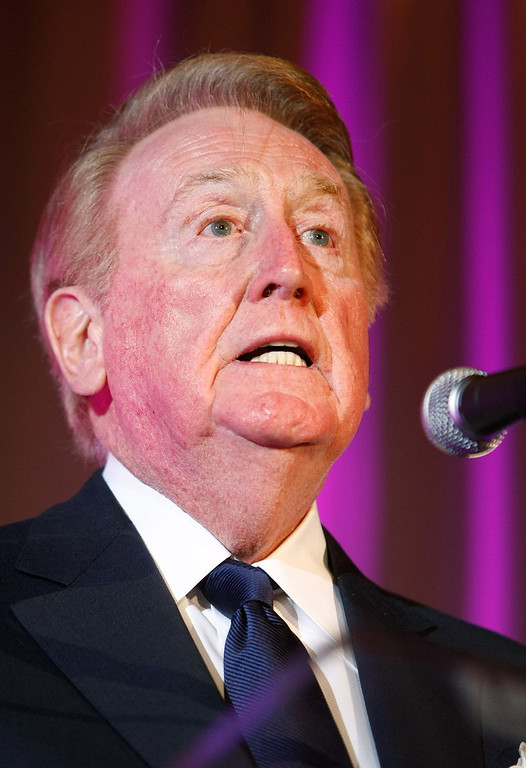 Description of . LOS ANGELES, CA - MARCH 09:  Los Angeles Dodgers announcer Vin Scully speaks during the 2009 AFTRA Media and Entertainment Excellence Awards at the Biltmore Hotel on March 9, 2009 in Los Angeles, California.  (Photo by Michael Buckner/Getty Images)
