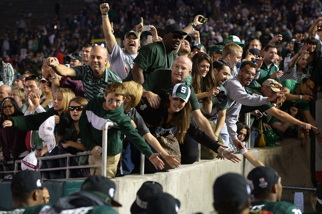 Description of . Michigan State fans cheer their team going back in the tunnel after beating Stanford 24-20 at the Rose Bowl, Wednesday, January 1, 2014. (Photo by Michael Owen Baker/L.A. Daily News)
