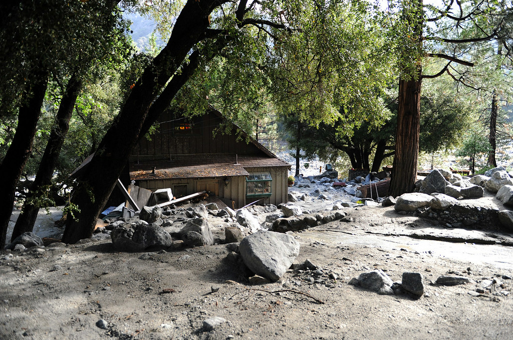Description of . Clean-up efforts take place after Sunday's storm caused flooding on Monday, August 4, 2014 in Forest Falls, Ca. (Micah Escamilla/San Bernardino Sun)