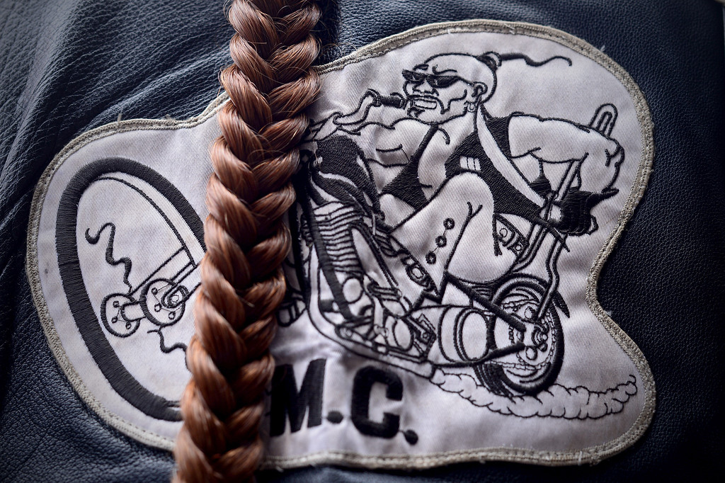 Description of . A braid hangs past a Mongols patch as motorcycle club members rally Saturday, March 29, 2013 at The House Lounge in Maywood in support of the Mongols who are facing a federal trial seeking to take away their trademark patch. (Photo by Sarah Reingewirtz/Pasadena Star-News)
