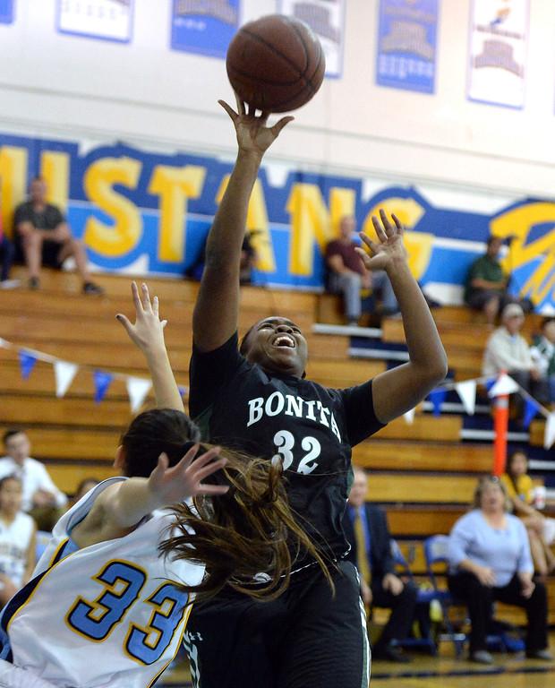 Description of . Bonita's Kandyce Smith (32) shoots past Walnut's Kim Mayekawa (C) (33) in the first half of a prep basketball game at Walnut High School in Walnut, Calif., on Wednesday, Jan. 15, 2014. Bonita won 60-50. (Keith Birmingham Pasadena Star-News)